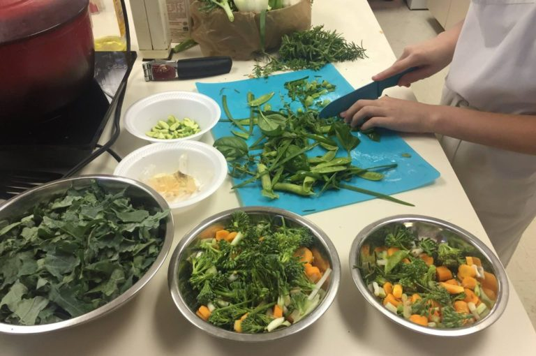 Magnolia Montessori Academy students prepare salad with vegetables from the school garden