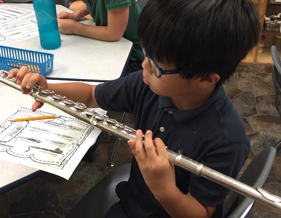 Student holds a flute