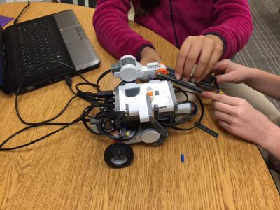 Magnolia Montessori Academy students work with LEGO Mindstorms Robot