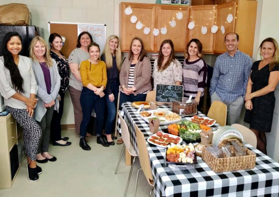 Magnolia Montessori teachers and faculty stand in break room